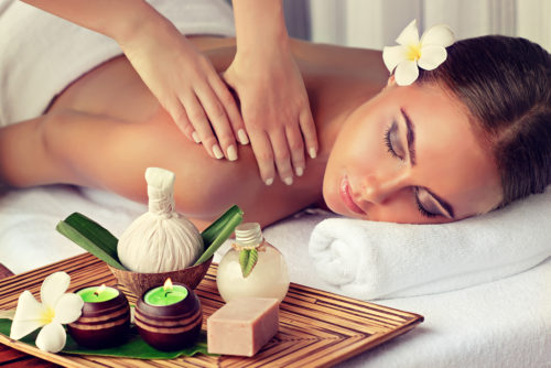 Body care. Spa body massage treatment. Woman having massage in t